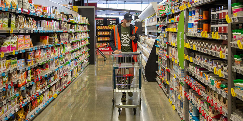 An SVA Grocery Delivery volunteer shopping during the lockdown