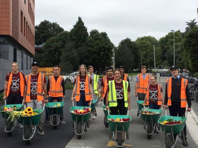 '19 UC SVA Executive with wheelbarrows and flowers provided following the Christchurch Attacks