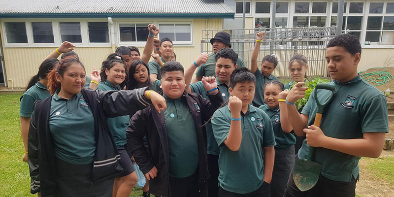 Students at Southern Cross Campus posing for a group photo